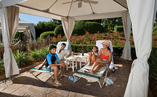 A family lounges at cabanas at Adventure Island located in Tampa Florida